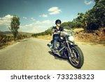 biker riding a motorcycle on an ...   Shutterstock . vector #733238323