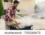 handsome young man preparing... | Shutterstock . vector #733260673