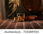 glass of whiskey and wooden... | Shutterstock . vector #733389553