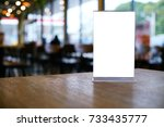 mock up menu frame standing on... | Shutterstock . vector #733435777