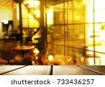 top of wood table with blur... | Shutterstock . vector #733436257