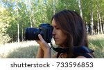 girl with camera with long lens.... | Shutterstock . vector #733596853