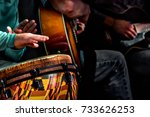 Small photo of A small acoustic band performing tunes on a street in the District of Columbia.