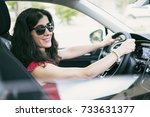 woman driving car and looking... | Shutterstock . vector #733631377