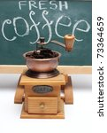 chalkboard and coffee mill close up - stock photo