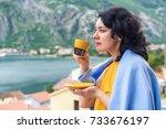 beautiful brunette woman drinks ...   Shutterstock . vector #733676197