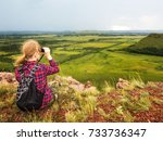 the girl sits on the mountain...   Shutterstock . vector #733736347