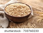 bowl with oatmeal flakes on... | Shutterstock . vector #733760233