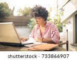 girl studying in a terrace   Shutterstock . vector #733866907