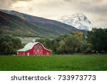 red barn on a stormy autumn day ... | Shutterstock . vector #733973773