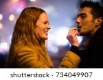couple on date   woman feeds... | Shutterstock . vector #734049907
