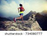 fitness woman trail runner...   Shutterstock . vector #734080777