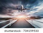 airplane in motion with blurred ... | Shutterstock . vector #734159533