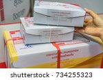 editorial use only  parcels at... | Shutterstock . vector #734255323