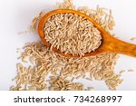 pile of  brown rice in a wooden ... | Shutterstock . vector #734268997