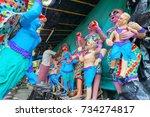 Small photo of KUMARTULI, KOLKATA, INDIA - OCTOBER 10, 2014 - Artist preparing clay idols of female demons to be used during Kali Puja, worshipping of Goddess Kali, Hindu festival of Deepavali or Diwali.