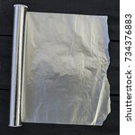 Small photo of aluminum foil,kitchen tools and utensils, aluminum foil used in kitchen, aluminum foil pictures in different concepts