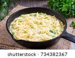 omelette with onion and cheese... | Shutterstock . vector #734382367