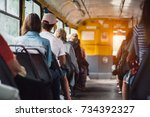 people have a ride in public... | Shutterstock . vector #734392327