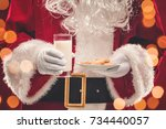 santa claus holding plate with... | Shutterstock . vector #734440057