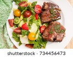 lamb chops with mint and summer ...   Shutterstock . vector #734456473