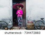 beautiful woman wearing nyonya... | Shutterstock . vector #734472883
