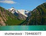 green glacial waters of the... | Shutterstock . vector #734483077