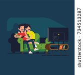 young couple watching scary... | Shutterstock .eps vector #734513287