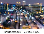 Small photo of Double espouse night blurred bokeh light city downtown, abstract background