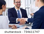 business handshake at meeting... | Shutterstock . vector #734611747