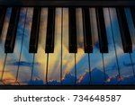 Small photo of Thunderous sky with clouds during sunset on the keys musical instruments piano, grand piano, synthesizer, concept of melody