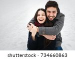 young beautiful enamored couple ... | Shutterstock . vector #734660863
