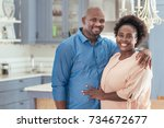 portrait of a smiling african... | Shutterstock . vector #734672677