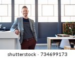 portrait of a confident young...   Shutterstock . vector #734699173