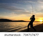 young man fishing at sunset | Shutterstock . vector #734717677
