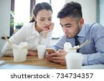 attentive co workers waching... | Shutterstock . vector #734734357