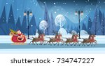 santa riding in sledge with... | Shutterstock .eps vector #734747227