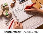 woman hands writing down... | Shutterstock . vector #734813707