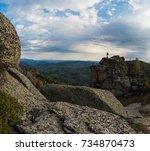 Small photo of Man on the peak of mountains of Altai. Kolyvan range - a mountain range in the north-west of the Altai Mountains, in the Altai Territory, Russia