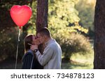 young love couple in park with... | Shutterstock . vector #734878123