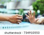 young man breaking cigarette   Shutterstock . vector #734910553
