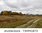 autumn landscape. dark clouds... | Shutterstock . vector #734941873