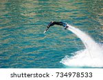 dolphin style during a flyboard ... | Shutterstock . vector #734978533