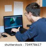 boy using a laptop | Shutterstock . vector #734978617