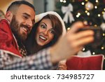 couple making selfie on... | Shutterstock . vector #734985727