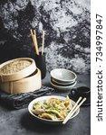 asian dumplings in bowl ... | Shutterstock . vector #734997847