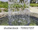 fountain basin with bubbling up ... | Shutterstock . vector #735017257