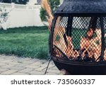 outdoor flame pit with roaring... | Shutterstock . vector #735060337