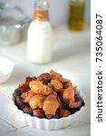 fried banana snacks with milk   Shutterstock . vector #735064087