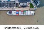 shipping cargo to harbor... | Shutterstock . vector #735064633